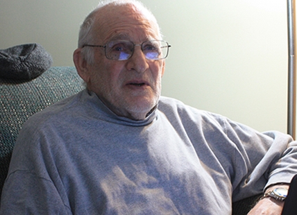 Bob Richards relaxing at home in Penticton. The 77-year-old ventures out in the evening supplementing his income by collecting recyclables in an effort to pay off a debt incurred after trying to help a family in need several years ago.