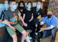 After about a month of treatment, Theo was re-homed. Amanda and Kurt's children are thrilled.