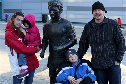 Shilo Lauinger, Amber Biglow and Liam and Logan next to a statue of Terry Fox, who lost his leg to an osteosarcoma in 1977.