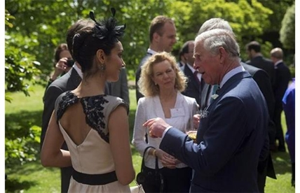 Britain's Prince Charles chats with Ta Canadian dancer with the Royal Ballet during a reception at St James's Palace in London, Wednesday, May 14, 2014.