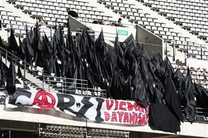 Supporters of Besiktas stand black flags to express their condolences for the victims of Soma mine accident before their Turkish League match in Istanbul, Turkey, Saturday, May 17, 2014.