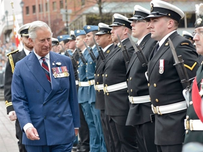 Prince Charles inspects honour guards in Halifax on Monday, May 19, 2014.