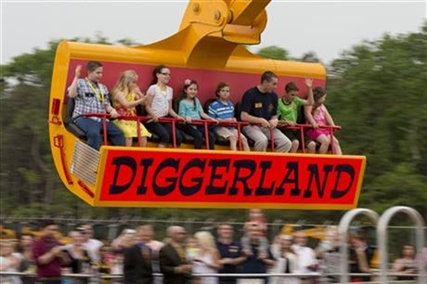 Guest ride in a modified excavator bucket during a preview day at Diggerland USA Thursday, May 22, 2014, in West Berlin, N.J.