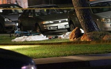 Bodies are seen covered on the ground after a mass shooting near the campus of the University of Santa Barbara in Isla Vista, Calif., Friday, May 23, 2014.