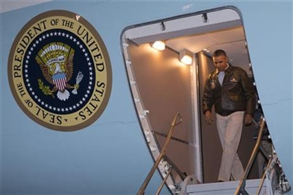 President Barack Obama steps off Air Force One after arriving at Bagram Air Field for an unannounced visit, on Sunday, May 25, 2014, north of Kabul, Afghanistan.