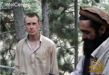 This file image provided by IntelCenter on Dec. 8, 2010, shows a frame grab from a video released by the Taliban containing footage of a man believed to be Bowe Bergdahl, left.