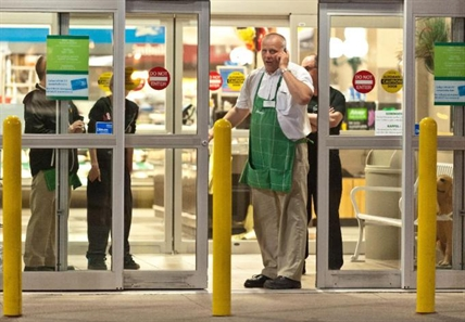 Employees of a grocery store lock down their store in Moncton, N.B. on Wednesday June 4, 2014.