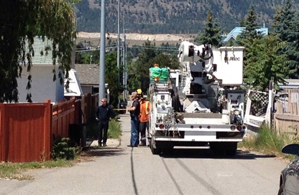 Hydro service arrives to turn off electricity to homes in the area while the investigation into a pipe bomb continues, June 6, 2014.