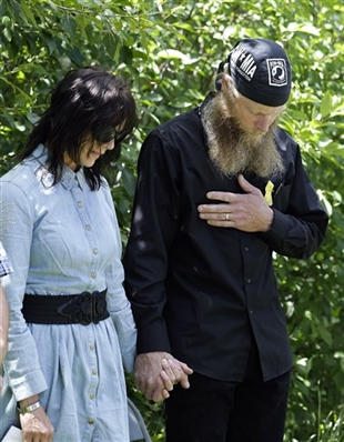 Bob Bergdahl, right, and Jani Bergdahl, the parents of U.S. Army Sgt. Bowe Bergdahl, pray at the