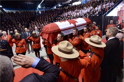 The casket of Const. Douglas James Larche, is carried into the Moncton Coliseum for the RCMP regimental funeral on Tuesday, June 10, 2014, in Moncton, N.B.