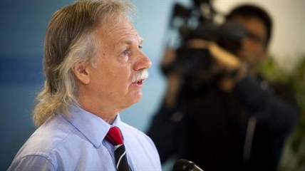 British Columbia Teachers' Federation President Jim Iker announces a full-scale strike for school teachers is set for Tuesday, June 17 during a press conference in Vancouver on Thursday June 12, 2014.