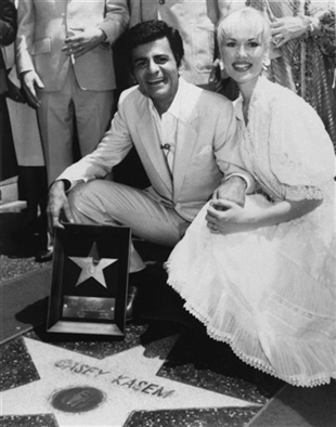 In this April 27, 1981 file photo, Casey Kasem and his wife Jean smile as he receives his own