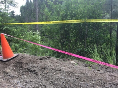 Police and Search and Rescue tape is up on Shuswap River Driver near Lumby on Sunday, June 15, 2014.