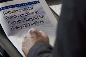 The technical analysis and requirements for B.C. to consider support for heavy oil pipelines is seen as British Columbia Minister of Environment Terry Lake speaks about the Northern Gateway Project during a news conference in Vancouver, July, 23, 2012.