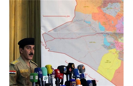 Iraqi Prime Minister's security spokesman, Lieutenant General Qassem Atta speaks during a press conference about the latest military development in Iraq, on June 28, 2014 in the capital Baghdad.