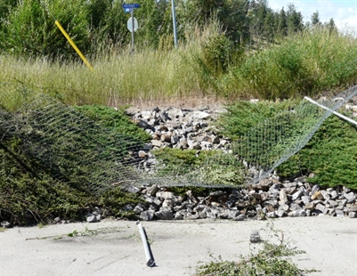 The driver of a BMW drove off this embankment and into the yard at the Emco Corporation in Kelowna.