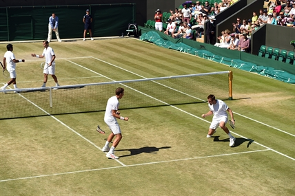 Vernon's Vasek Pospisil, left, and his partner American Jack Sock celebrate their Wimbledon men's doubles semifinal win against Leander Paes of India and Radek Stepanek of Czech Republic Friday, July 4, 2014.