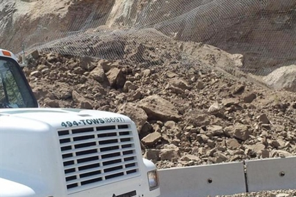 The pile of rock that slide down a rock face along Highway 97 just north of Summerland on Sunday, July 6, 2014.