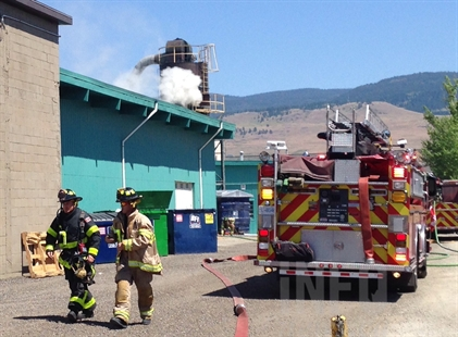 A small plume of smoke can be seen coming from an industrial hopper at a commercial building on Pinto Road, July 9, 2014.