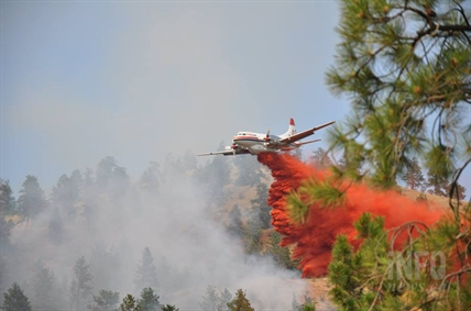 An air tanker drops retardant on a fire in West Kelowna Tuesday afternoon.
