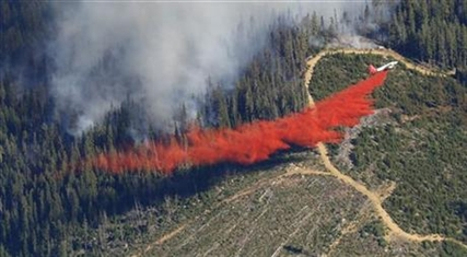 A plane drops fire retardant on the Chiwaukum Creek Fire near Leavenworth, Wash., Thursday, July 17, 2014.