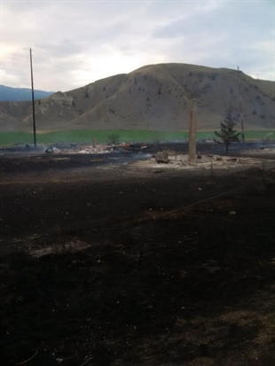 A picture from Twitter on Saturday, July 29, 2014 shows what is left after a fierce fire burned down four empty buildings in Ashcroft overnight.