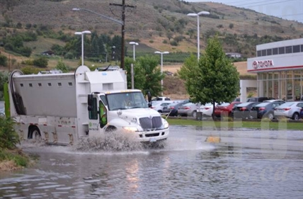 A truck navigates a flash flood area during a storm in Vernon, July 23, 2014.