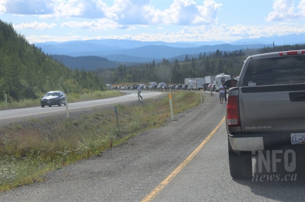 Motorist, many in RV's take a moment to stretch their legs with traffic at a standstill following an accident on Highway 97C near the Loon Lake Road exit, Friday, July 25, 2014.