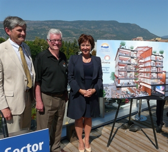 B.C. Minister of Technology Andrew Wilkinson, left to right, Kelowna Mayor Walter Grey and B.C. Premier Christy Clark with an artist's rendering of the Okanagan Centre for Innovation, Monday, July 28, 2014.