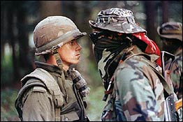 Pte. Patrick Cloutier, a 'Van Doo' perimeter sentry, and Mohawk Warrior Brad Larocque, a University of Saskatchewan economics student, face off during the Oka Crisis in 1990.