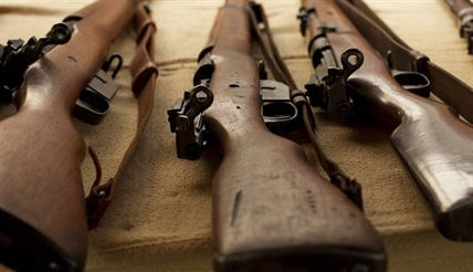 Canadian-made, WWI-era Ross rifles, owned by collector Bob McCormick, are shown at his home in Haldimand, Ont., on Thursday, August 7, 2014.