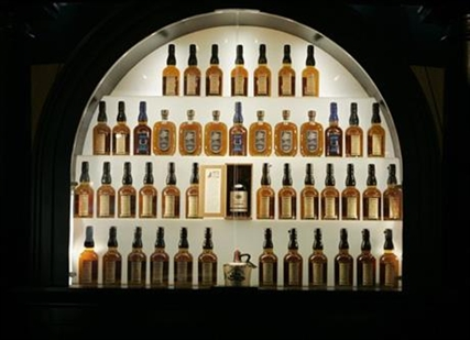 In this Wednesday, April 8, 2009, file photo, bottles of bourbon are on display in a case at the Heaven Hill Bourbon Heritage Center in Bardstown, Ky.
