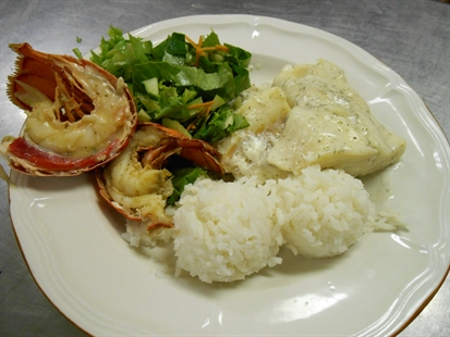 The hungry received a delicious plate of lobster, sole, salad and rice at the Kelowna Gospel Mission, Aug. 21, 2014.