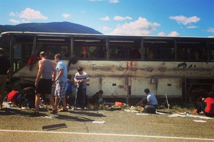 A tour bus is badly damaged and many people injured following a crash on the Coquihalla Highway Thursday, Aug. 28, 2014.