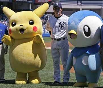 Yankees' Hideki Matsui, center, poses with Pokemon characters Pikachu, left, and Piplup.