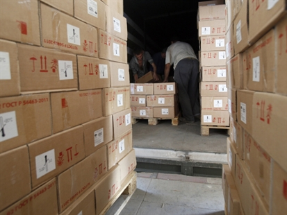 Workers unloading aid delivered from Russia in the town of Luhansk, eastern Ukraine, Saturday, Sept. 13, 2014.