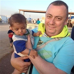 This undated family handout photo shows British man Alan Henning, currently held hostage by Islamic State (IS) and whose life was threatened in the IS video in which they beheaded David Haines.