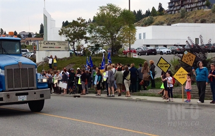 More than 200 people gathered along Rogers Way to wait for Premier Christy Clark and cabinet members to arrive, Sept. 17, 2014.