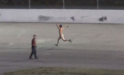 The crowd at the Motoplex Speedway in Spallumcheen cheered as a streaker ran the track between races on Saturday, Sept. 13, 2014.