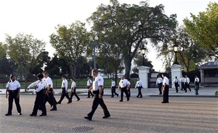 Uniformed Secret Service officers walk along Pennsylvania Avenue in front of the White House, Saturday, Sept. 20, 2014.