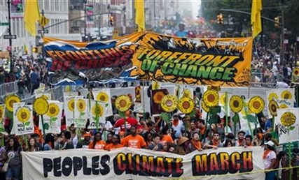 People gather before the People's Climate March in New York Sunday, Sept. 21, 2014.