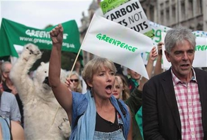 British actress Emma Thompson, centre and John Sauven from Greenpeace join an estimated 40,000 thousand people marching in London, Sunday, Sept. 21, 2014 as part of the People's Climate March.