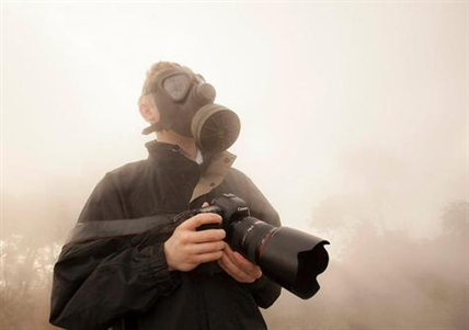 Kelowna photographer Shawn Talbot puts on a gas mask and jacket to protect himself from the blazing heat emitting from the lava.