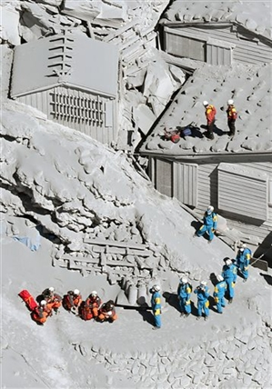 Firefighters and members of the Japan Self-Defense Forces prepare to rescue climbers near the peak of Mount Ontake in central Japan, Sunday, Sept. 28, 2014.