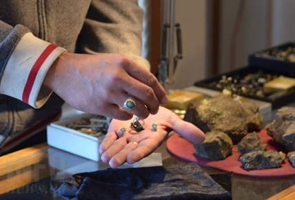Donna Nelson's find has already been converted into unique pieces of jewelry. The Opal Miners Gift Shop crafts visitor's opals into one of a kind jewelry on site.
