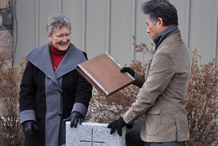 Chairman of St. Paul's board Judy McAulay and Reverend Doctor Richard Chung with the time capsule found under St. Paul's United Church.