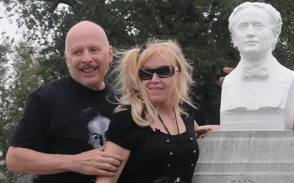 Dorothy Dietrich, right, and Dick Brookz pictured in front of the restored bust on the granite monument at Houdini's grave.