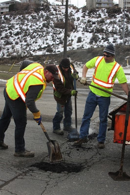 Public works employees along Mission Flats Road in Kamloops earlier this year.
