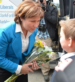 Isaac White, 11, says he was excited to give a bouquet of flowers to Christy Clark, even though he's not that familiar with her campaign.
