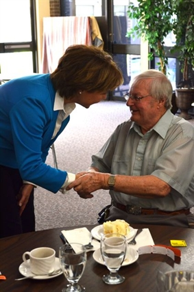Alfred English, 90, says getting a birthday hug from Christy Clark made his day.